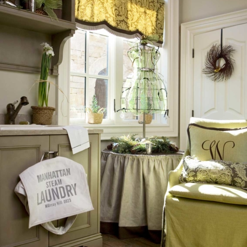 Laundry and powder room soft green upholstery, vanity, and mirror