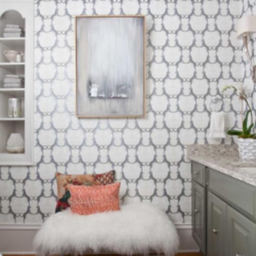 Elegant bathroom design with custom wallpaper and decorative pillows